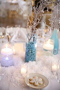 Sprinkle our realistic fake snow on tables and mirrors or used in glass bowls for unique, winter-themed wedding or holiday centerpieces. www.yourweddingcompany.com