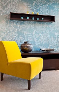 A bright yellow chair plays nicely with laid back blue wallpaper.  #devinecolor #mimosa
