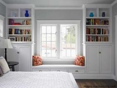 Why not put book cases on either side of a window..they did this using Ikea wardrobe closets.