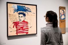 A person looks at the Untitled (Pablo Picasso), 1984 on show at the exhibition Basquiat: Boom for Real. Running until 28 January 2018 at Barbican Art Gallery on September 19, 2017 in London, England.