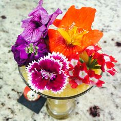 Spring Special smoothie ❤️ mango, homemade almond milk, ginger and pineapple. Topped with beautiful edible flowers.