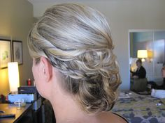 Braids and curls combined into a beautiful low bun.