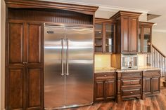 Custom Built Maple Cabinets with built-in stainless espresso machine and built-in Viking refrigerator