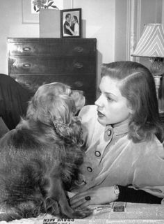 """Pup: """"..and then..."""" Bacall: """"What? What did they say then???"""" Pup: """"They said I was ADOPTED!!""""  Bacall:  """"No, honey... It's not true... I promise.  I love you as if you were my very own..."""""""
