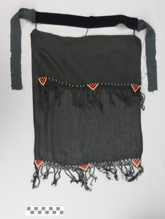 Black face veil made from two layers of cloth, which are decorated with beading and fringing along the two, transverse edges. The headband is made from a black velvet ribbon. Saudi Arabia traditional outfit