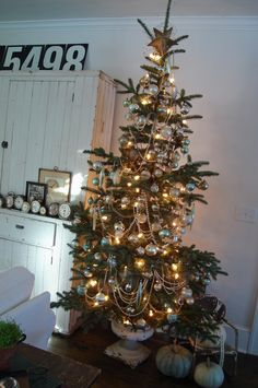 is it weird to repin of pic of my own home?? lol...this was the year of the skinny tree!
