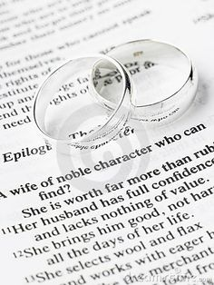 Wedding Ring with bible Pictures | Wedding Rings Resting On A Bible Stock Photo - Image: 8756160