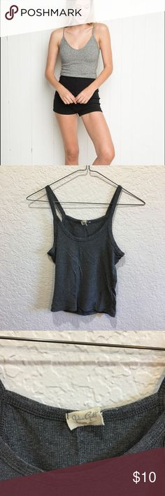 Grey Brandy Melville Tank Not the exact one pictured in the first photo, but pretty darn close. Never worn! NWOT. My photo is a little dark, it's a medium grey not super light or dark. No trades or pp. OS. John Galt take is only attached on one side Brandy Melville Tops Tank Tops