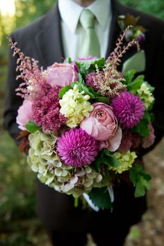 Love dahlias David austens astilbe fuchsia and green bouquets...would substitute white garden roses or hydrangeas for the green