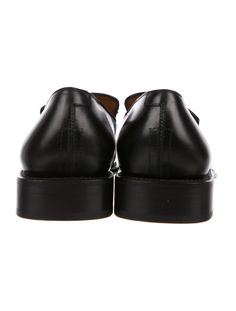 lowest price 45af0 8a70d Men s black leather Salvatore Ferragamo Norman round-toe loafers with  tassel accents at upper and