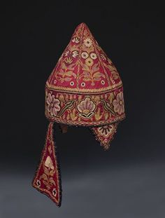 Hat | V&A Search the Collections Hat Place of origin: Gujarat, India (made) Date: 20th century (made) Artist/Maker: Unknown (production) Materials and Techniques: Embroidered satin with floss silks, lined with cotton Museum number: IS.135-1960 Gallery location: In Storage