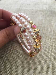 Pink Pearl and crystal memory wire bracelet with gold accents Olibellacreations at Etsy