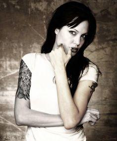 woman half sleeve tattoo | 15 Groovy Angelina Jolie Tattoos | CreativeFan