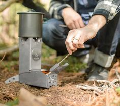"Hot Ash Stove Rocket Stove is a camping, bushcraft stove that makes it easy to cook, boil water, and a myriad of other things in an efficient and safe manner. The stove's design uses the principles of primary, and secondary burns that help get rid of harmful creosotes that are found in traditional campfires. Weight: 3 lbs Assembled Dimensions: 3"" W x 7.25"" D x 8.9"" H"