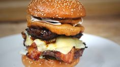 The Beef Royal from BBQWhiskyBeer in #London: loaded with short rib, bacon, cheese, onion rings, and mushrooms. Oh, and a burger.