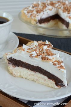 Easy no bake coconut cheesecake topped with chocolate fudge pudding. This is one delicious pie!