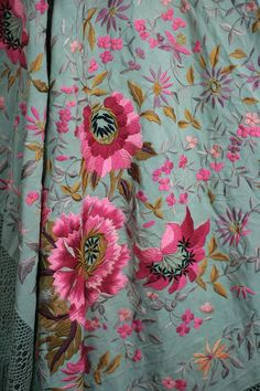 Embroidered celadon silk piano shawl 1920s.  Heavy celadon silk is completely embroidered,covered with amazing fuschia tones florals and foliage.  Embroidered to be completely reversible. Thick silk hand knotted fringe on all sides. Spanish origin.