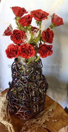 Custom steel vase and a dozen roses I completed for a client.  Up cycled from a garage door spring