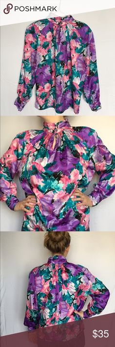 Vintage satin top from the 80s! This super cool vintage floral top from Worthington is sure to get people's attention. It has shoulder pads, little buttons on the neck and sleeves, and is super soft! If you are looking for something unique and retro, this top is for you. Fit would be medium or large. #vintage #80s #shoulderpads #satin #soft #flowers #floral #buttons Worthington Tops