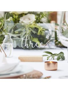 Place acrylic sheets within the wooden holders provided to stand the numbers up. Top your tables with these simple acrylic table numbers. Table Number Stands, Table Set Up, A Table, Cork Table, Botanical Wedding Theme, Future Mrs, Acrylic Table, Wedding Table Numbers, Wedding Table Themes