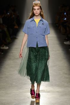 Borrowing From The Boys Steal-your-boyfriend's-style has moved on from leather jackets and baggy jeans. Instead, look to his boxy shirt options to pair with feminine fabrics and a simple T-shirt. Awkward colour combinations work best, as seen at Rochas.