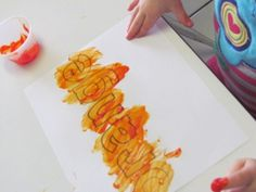 Painting color names with different kinds of paint and sensory materials