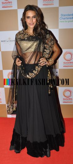 Neha Dhupia attends the Swades Foundation in black and gold lehenga by Vikram Phadnis http://www.kalkifashion.com/