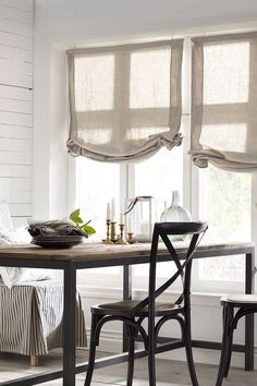 Simple, relaxed linen roman shades are a timeless classic.