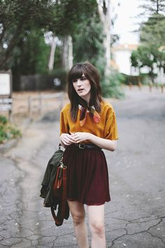 Love maroon. That skirt is lovely, although a tad short for my taste.