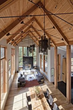 """Tahoe Ridge House / WA Design Inc. The experience of flow along the axes is enhanced by a clear rhythm of 10"""" x 10"""" recycled Douglas fir structural posts that tie in with the roof framing above."""