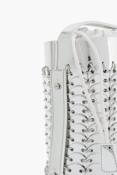 """$1,090.00  DESCRIPTION  14#01 Mini Bucket Bag in silver by Paco Rabanne.  Chain mail cylindrical crafted metallic leather discs accented with silver-tone rings.  Adjustable shoulder strap with collar studs at side.  - 6.25"""" H x 4.5"""" D  - 17"""" Strap  - 100% Calf Leather  - Made in Italy"""