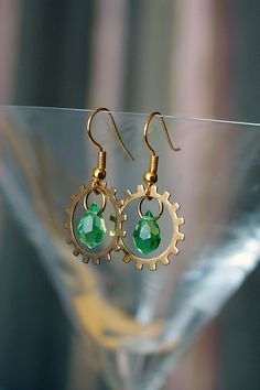 Steampunk brass gears and green glass drops by DevilsJewel on Etsy, $25.00