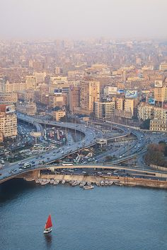 ✮ Busy junction and The Nile with traditional boat - Cairo, Egypt