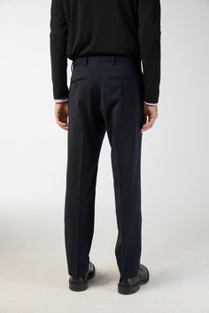 A regular fit with a slightly tapered leg, these classic tailored trousers are styled from plain-woven wool, a fine yet strong fabric with natural resistan