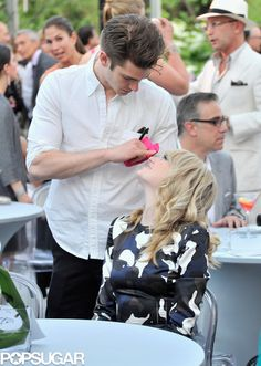 Andrew Garfield Cant Get Enough of Emma Stone: Emma Stone and Andrew Garfield played around during the benefit.