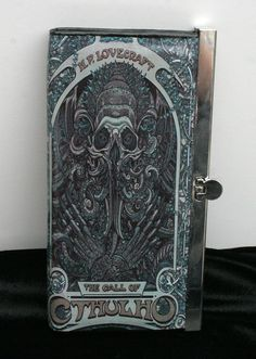 Cthulhu Wallet Lovecraft Wallet Science Fiction Wallet SciFi Wallet Horror Wallet Gothic Wallet Literature Wallet Book Wallet Cthulhu Clutch  Front side features an artist concept of Lovecrafts Cthulhu very intricately illustrated. The back side features the quote: That is not dead which can eternal lie, And with strange aeons even death may die. The quote is printed against a great gritty background. *HOW LONG DO ORDERS TAKE? Orders currently have a 4-6 week production time. Please contact…