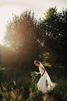 I love the dark trees behind, making the white crisp and bright. Also- the walking, natural bride.