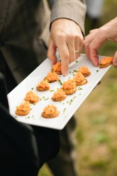southern inspired wedding menu. pimento cheese on top jalapeno corn cakes, green onion www.cateringoutfit.com