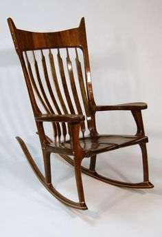 These chairs are the definition of comfort, boosting hand carved seats, flexible back braces, and sculpted joinery.  The chairs are tailored to fit the human body while looking great doing it. Every joint is hand-cut, and hand sculpted for flowing lines that run throughout the piece.  Legs shape, arm rests, and headrests are all customizable.    Made to Order