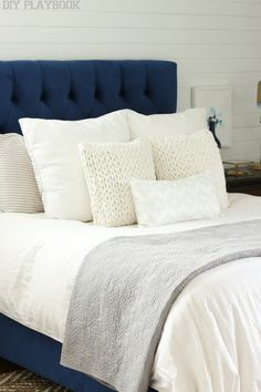 Use a navy headboard and textured white bedding for a comfortable relaxing bedroom look. This decor looks serene and great for a simple bedroom. Navy Bedrooms, Gray Bedroom, Modern Bedroom, Bedroom Decor, Master Bedroom, Bedroom Ideas, Navy Headboard, Navy Bedding, Design Seeds