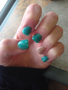 Turquoise and gold glitter ring finger