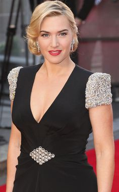 Kate Winslet.... embellished shoulders with accent belt