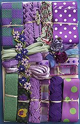 Crazy Quilt Embellishment Assortment - Purples Assorted  Assorted Purples Crazy Quilt Embellishment Assortment - A variety of vintage and new materials. Each assortment is one of a kind and unique, and may include some of the following items: ribbons, trim, lace, pearl buttons, venise, embroidery thread, and even old stamps. Let us choose an assortment for you.  Price: $30.00