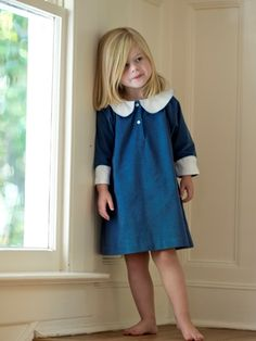 We based this design on a vintage find. Sized generously with raglan style 3/4 length sleeves, our dress is accented with a large white pique collar and cuffs with embroidered blanket stitching embellishment. Available in blue or red  fine cotton corduroy.  $72.00