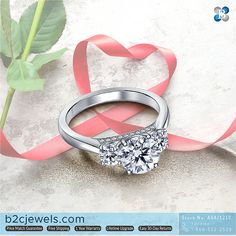 The glittering gallery of this gorgeous three stone engagement ring is a special surprise! Stock No: ASAJ1210