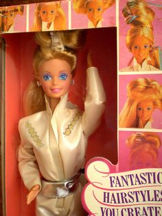 Super Hair Barbie- I have this Barbie somewhere. I remember the hair clip being fixated to her head, and was kinda annoying since you couldn't remove it. :)