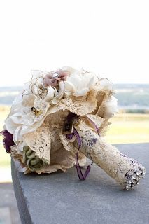 This bride took the lace from her mother's wedding dress and wrapped it around her bouquet. There are so many ways to incorporate your mom on your wedding day. This bouquet is. Lace Bouquet, Fabric Bouquet, Bouquet Wrap, Boquet, Diy Bouquet, Homemade Bouquet, Bouquet Flowers, Rustic Bouquet, Brooch Bouquets