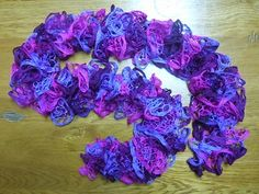 how to crochet a ruffle scarf with Starbella yarn. Different pattern than the silver scarf I pinned! It depends on whether you use red heart sashay or starbella.