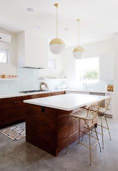 Beautiful white and walnut kitchen with brass accents // mid century modern inspired kitchen design decor ideas