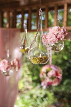 Beautiful hanging arrangements create a stunning garden feel